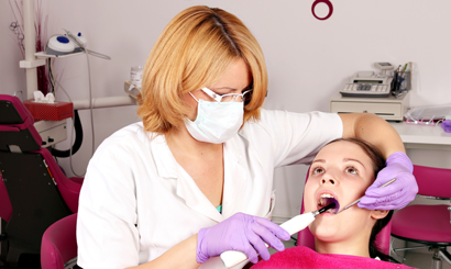 girl patient and dentist in dental office