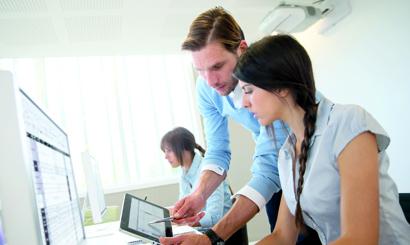 Business people working in office on desktop computer