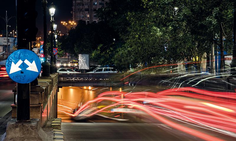 Bucharest, Romania ? July 7, 2015 ? Night traffic on Bratianu Boulevard in Bucharest, Romania.